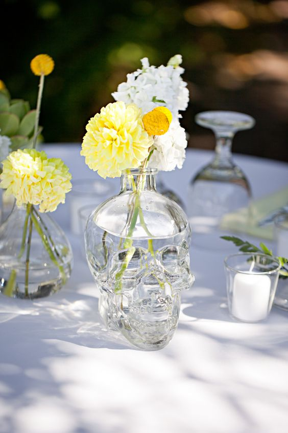 a skull vase with colorful blooms is a unique take an a usual vase