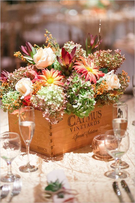 a wine box with various blooms will be a great idea for a vineyard wedding