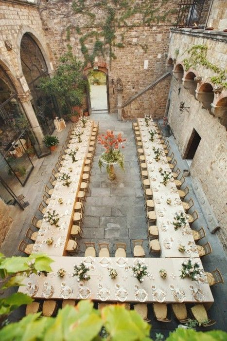 wedding reception placed in a castle inner courtyard is a great idea if the weather is good