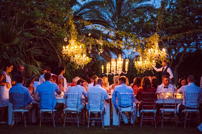 Candles and glam chandeliers lit up the reception at night