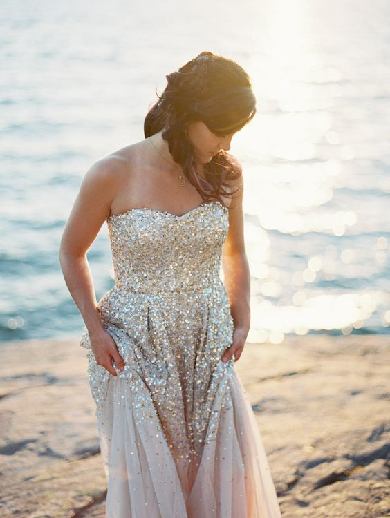 a strapless sweetheart wedding dress in blush with a silver sequin bodice and part of the skirt