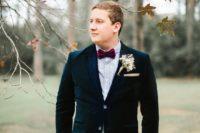 12 burgundy velvet pants, a navy velvet jacket, a light blue shirt and a burgundy bow tie