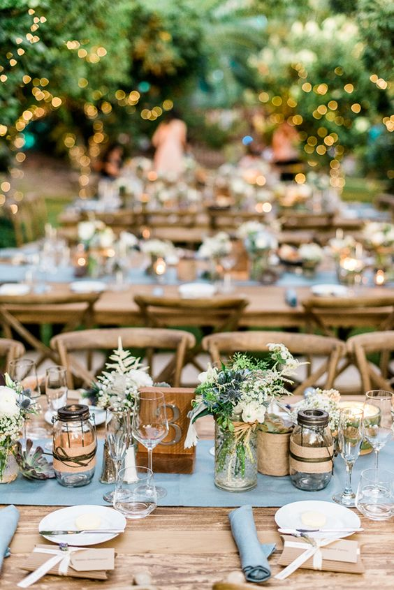 candle lanterns, wood table numbers, simple wildflowers for a rustic wedding reception