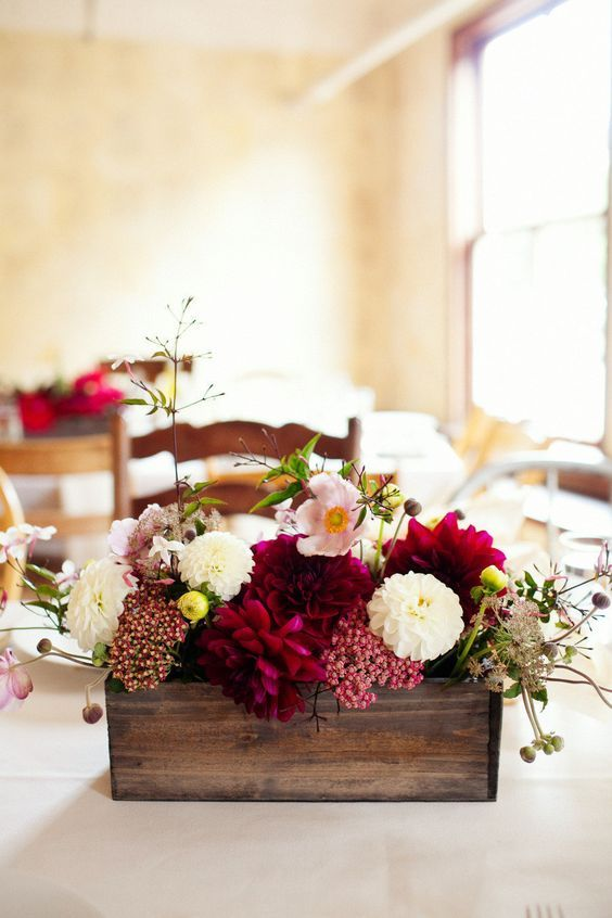 a dark stained wooden box with bold fall blooms will be amazing for your autumn celebration
