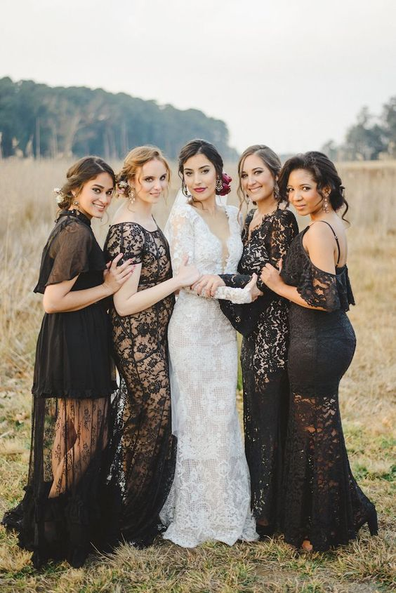 mismatching black lace bridesmaids' dresses and a white lace gown for the bride to stand out