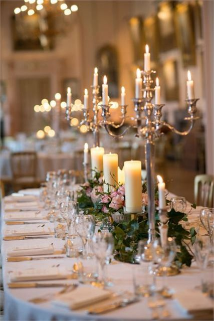 opt for refined wedding decor with candelabras, lush florals and candles
