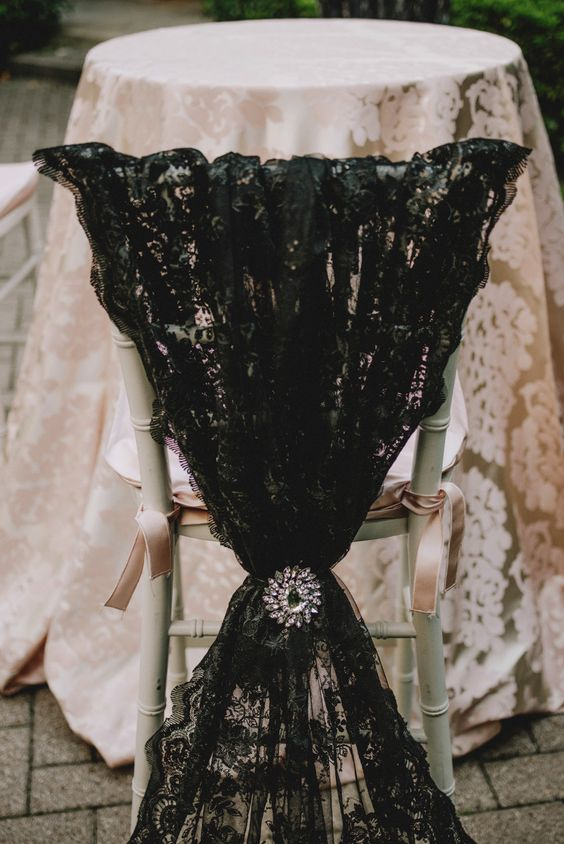 A Black Lace Chair Cover With A Vintage Holder And A Black Lace Tablecloth  For A