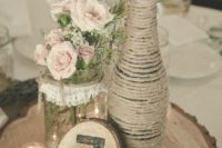 16 a jute wrapped bottle, a lace wrapped jar, a wood slice table number and blush roses