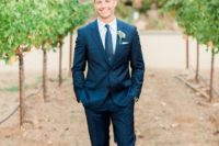 16 a navy two piece wedding suit with a matching tie and cognac shoes