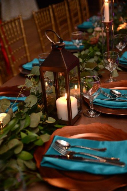 If you are getting married in the fall opt for a bold and unusual color scheme: teal and copper. This is a very refined combo!