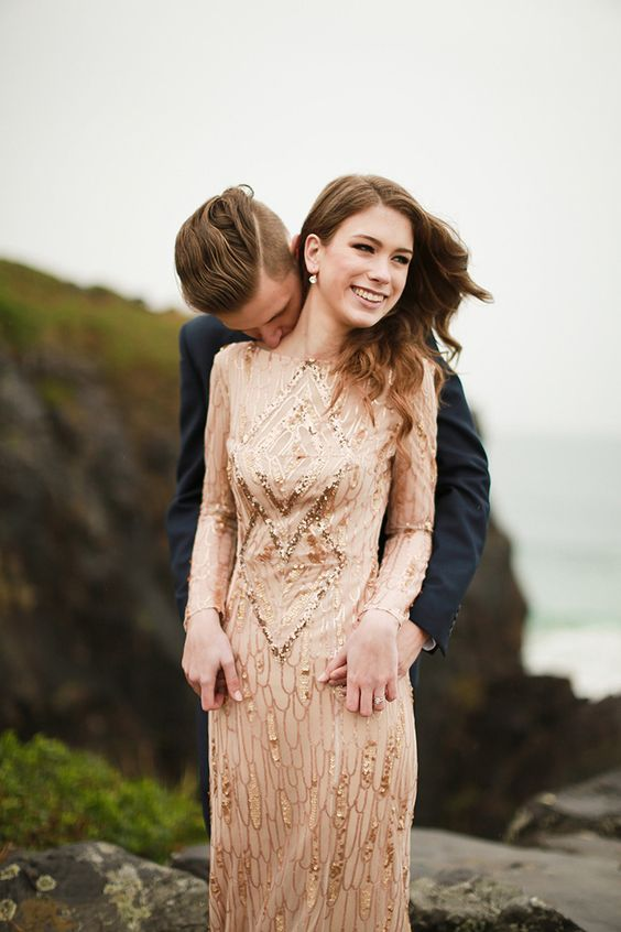 elegant blush and gold sequin wedding dress with a low back and long sleeves