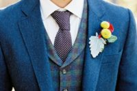 17 a bold blue suit, a checked vest and a knit printed tie
