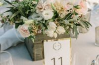 17 a reclaimed wood box with soft neutral blooms and greenery is easy to make yourself