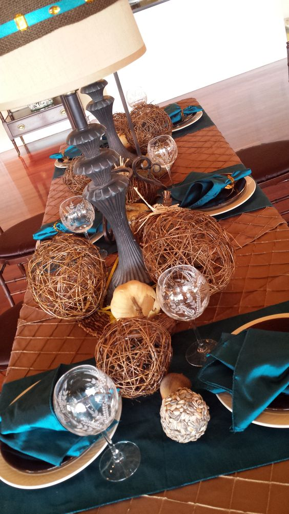 copper and teal wedding tablescape with large balls and printed glasses