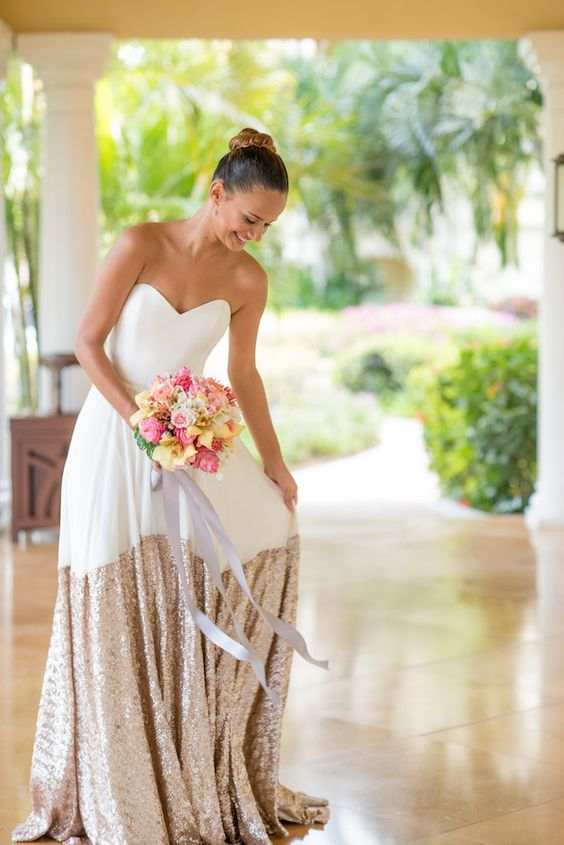 strapless sweetheart creamy wedding dress with a copper sequin skirt and a train by Truvelle