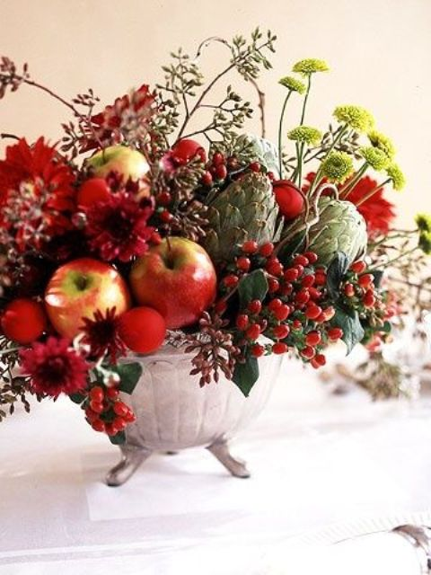 a bold fall or winter centerpiece with apples, berries, artichokes and textural blooms and leaves