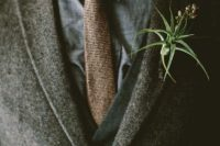 18 a brown tweed suit, a grey vest and shirt, a brown printed tie