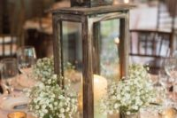 18 a reclaimed wood candle lantern, baby's breath in mercury glass vases and candles for a cute centerpiece