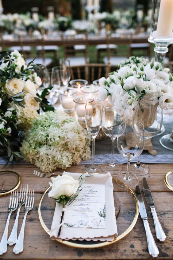 beautiful tablescape with lush white florals and gold touches and some rustic touches
