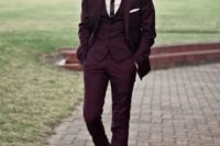 19 a burgundy three piece wedding suit with a thin striped tie and black shoes