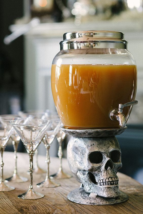 a skull drink stand and skeleton hand glasses will look amazing at a Halloween wedding