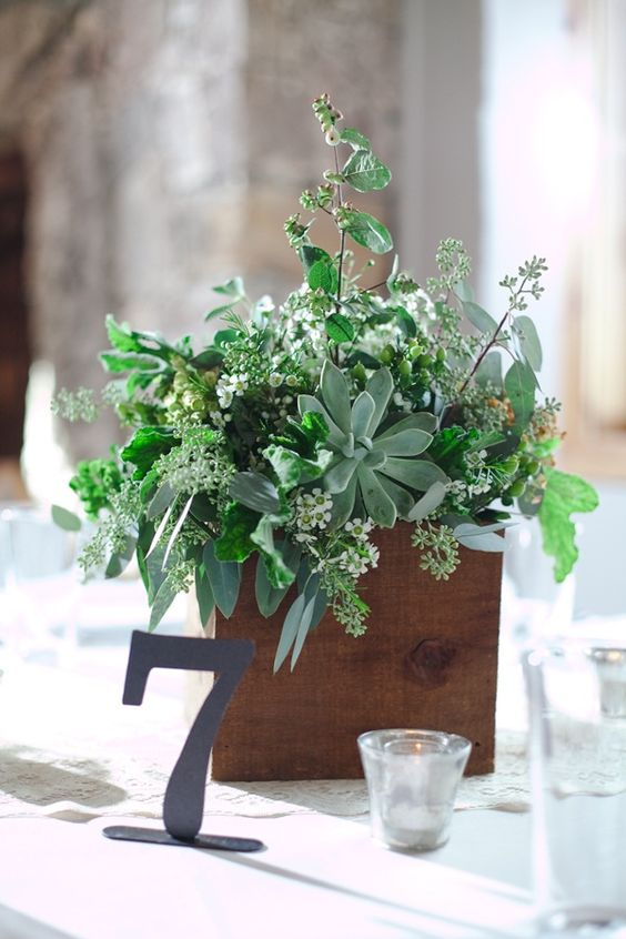 a wooden box with herbs, greenery and succulents for a relaxed woodland wedding