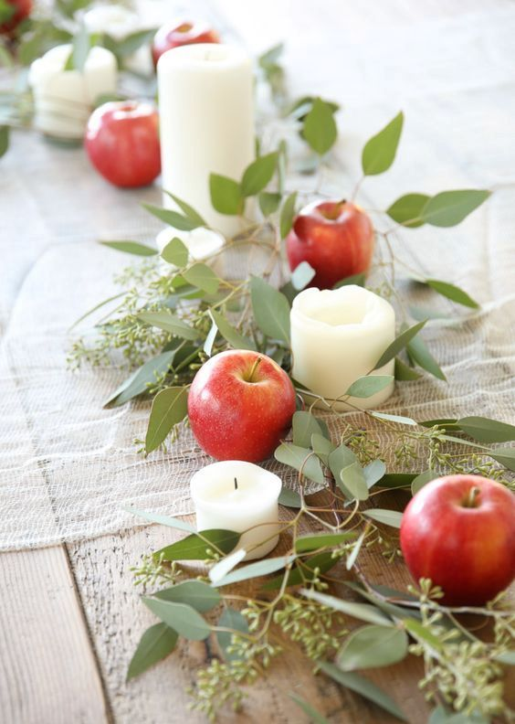 a beautiful fall table runner with eucalyptus, candles and apples will be heavenly