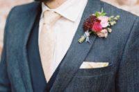 20 a grey tweed suit, a navy vest, a pink tie