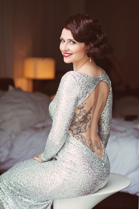 backless silver sequin wedding dress with long sleeves to show off the bride's tattoes