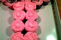 20 pink cupcakes served in a certain way for a bachelorette party