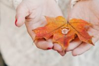 20 show off your engagement ring on a colorful fall leaf