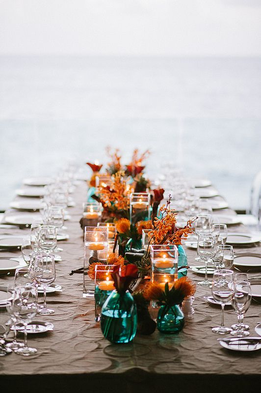 teal vases and jars with copper and orange blooms are ideal for a fall table setting