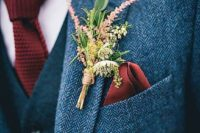 21 a grey tweed three piece suit with a red knit tie and a wildflower boutonniere