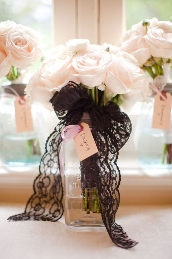 blush roses with a black lace bouquet wrap for an elegant and chic look