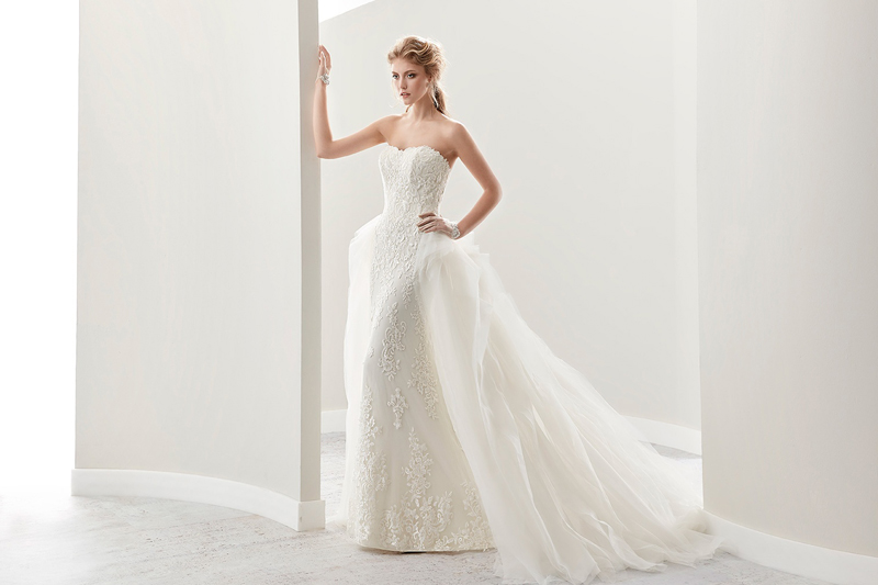 strapless lace sheath wedding dress with a lace overskirt that turns it into a beautiful ballgown