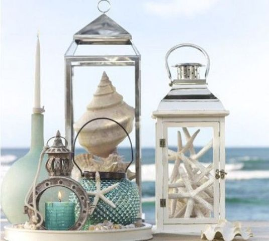 beach-inspired lanterns with starfish, seashells are a great idea for a seaside wedding