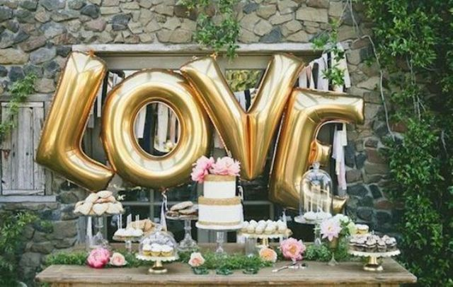 giant LOVE letter balloons for a dessert table backdrop