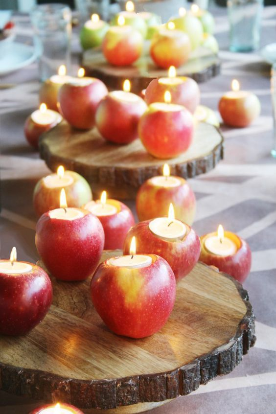 apple candle holders on wood slices can be a nice idea for a rustic fall wedding