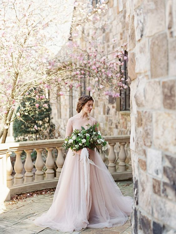 stunning spring bridal portrait in the castle courtyard with cherry blossom