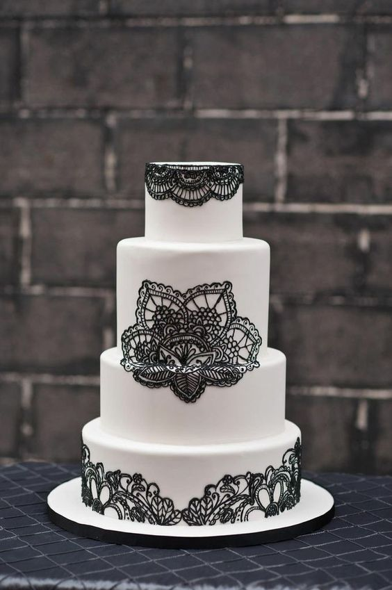 a chic white and black lace wedding cake will be a great fit any modern wedding