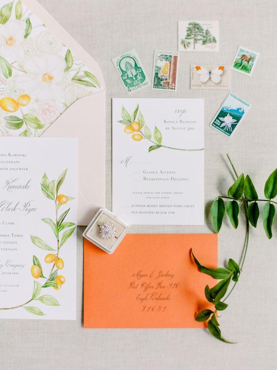 wedding stationary with an orange envelope and kumquat prints