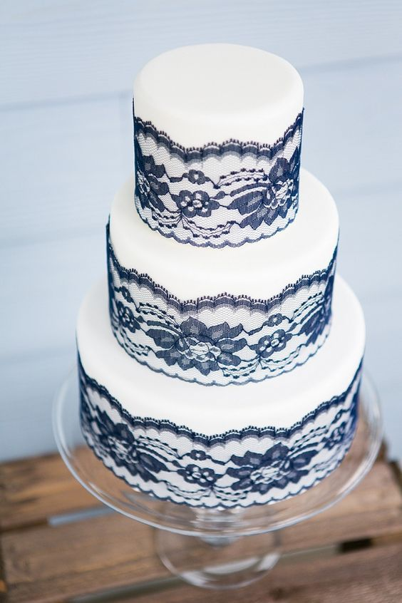 a white and black lace wedding cake is a chic and elegant idea