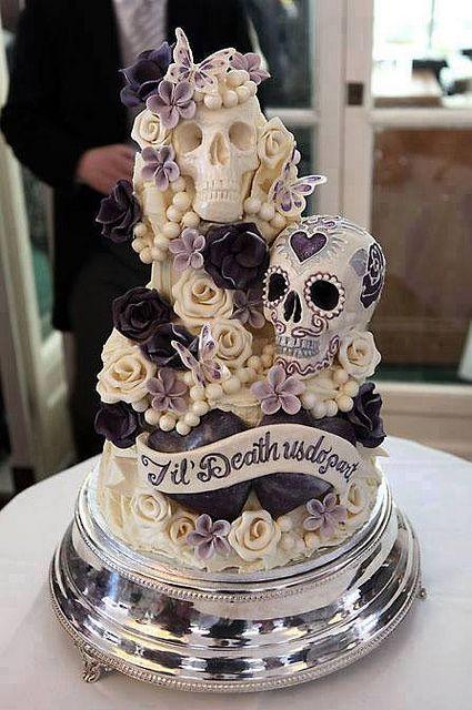 bloom and sugar skull wedding cake for a Halloween wedding