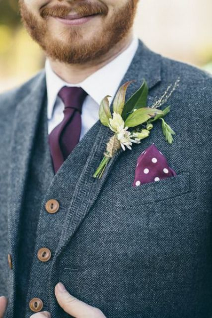grey tweed three piece wedding suit with a plum tie and handkerchief