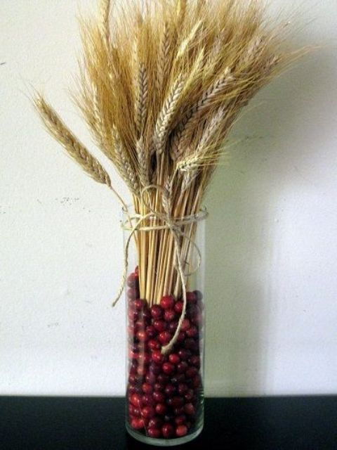 wheat and cranberry glass jar centerpiece for a fall wedding