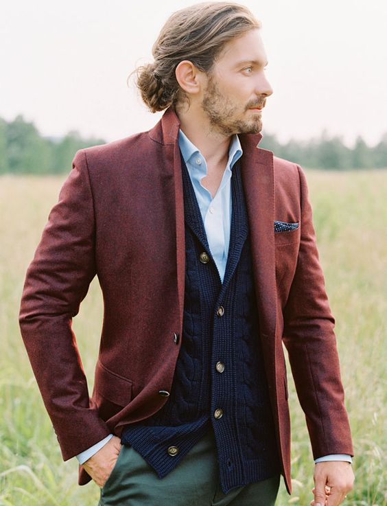 green pants, a maroon jacket, a navy cardigan and a blue shirt for a stylish layered look