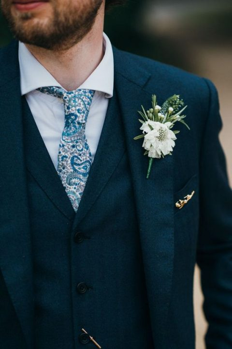 a navy tweed three piece wedidng suit with a whimsy printed blue tie