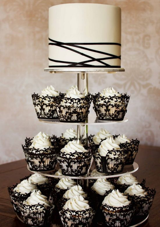 black lace cupcake covers and a black and white strappy wedidng cake look like a perfect combo