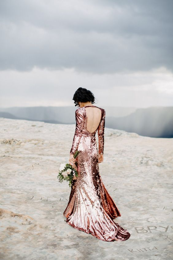 pink sequin long sleeve backless wedding dress with a small train looks stunning and shining