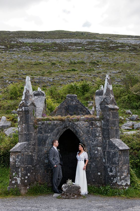 a couple pictured in an Irish castle courtyard that looks vintage and beautiful